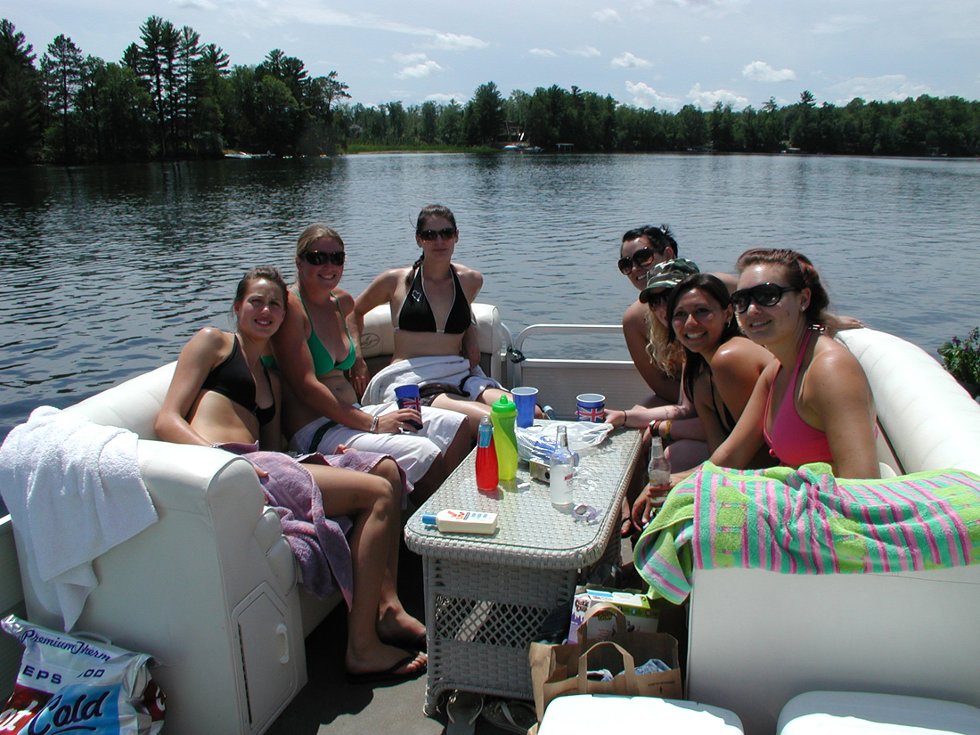 Minocqua Pontoon Cruises group having fun on pontoon boat